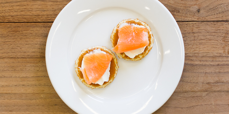 Smoked salmon (56g) and reduced fat soft cheese (30g) on two mini blini (17g) pancakes